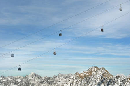 Winter Holiday Gondola Ski Lift Above Alps Mountains Stock Photo - 8651758