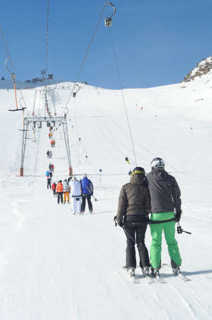 T bar ski lift pulling skiers up the slope. Perfect winter in European Alps. photo