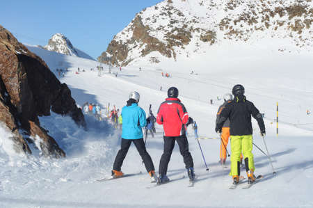 Skiers having fun on wide slopes of Austrian glacier in Solden. photo