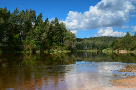 gauja: river and passing clouds Stock Photo