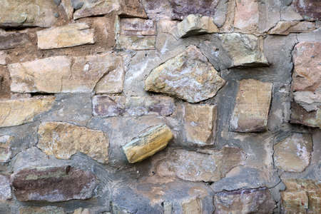 gravelly: Weathered rock wall texture Stock Photo