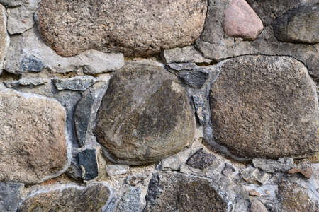 gravelly: Granite stone wall texture