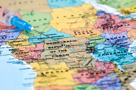 drug discovery: syringe on a map of africa