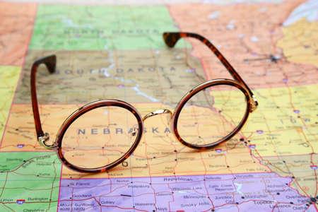 nebraska: Glasses on a map of USA - Nebraska Stock Photo