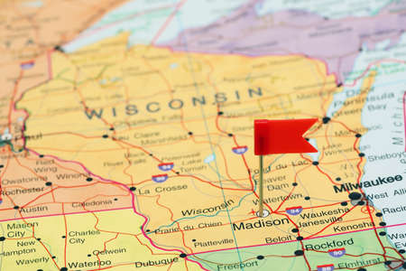 wisconsin flag: Madison pinned on a map of USA