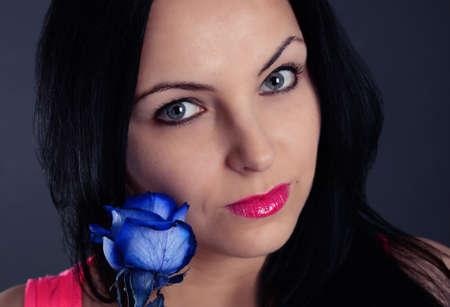 blue rose: woman with a blue rose Stock Photo