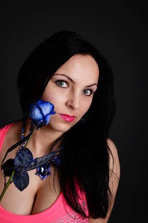 hot breast: sexy woman with a blue rose Фото со стока