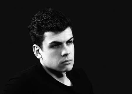 considerate: stylish bw young man portrait Stock Photo