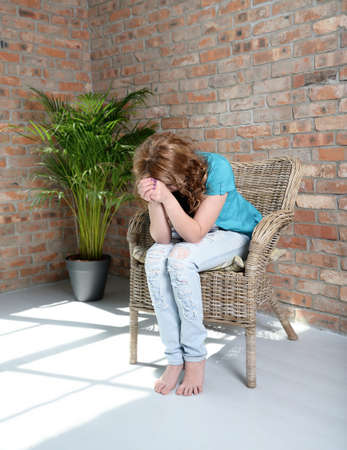despaired: woman sitting on the chair in depression