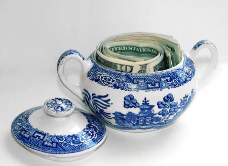 stash: Money Saved in a Sugar Bowl Stock Photo