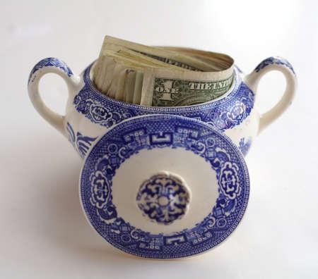 stash: Money saved in a sugar bowl.