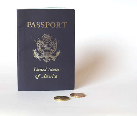 Passport and some 20 cent Euro coins. Space on the right for text, etc. Stock Photo