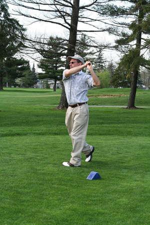 Golf follow through Stock Photo