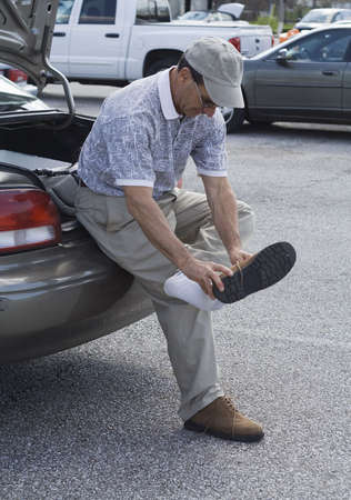 Changing shoes in parking lot - after golf.