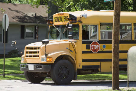 Public school bus in suburban neighborhood photo