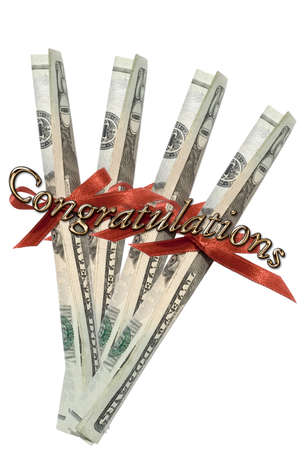 Congratulations script in gold metallic letters; twenty american dollar bills rolled and tied with red ribbons Stock Photo