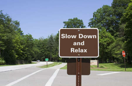 Roadside sign - Slow down and relax Stock Photo