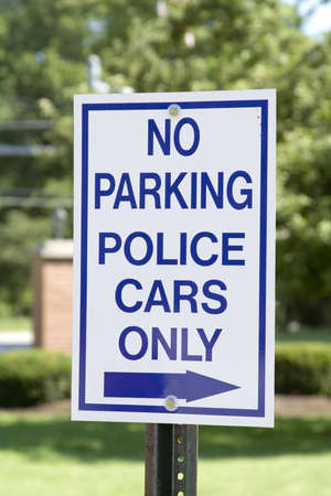 Sign posted outside a police station.  No parking - Police Only.
