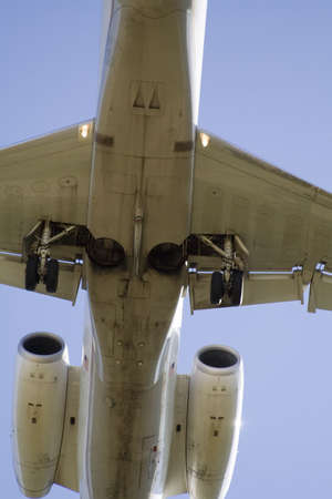 Underside of a Jet as it flys overhead close to the ground - approach for landing. photo