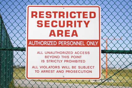 restricted: Never sharpened; restricted security sign posted on fence of Cleveland Hopkins airport. Stock Photo