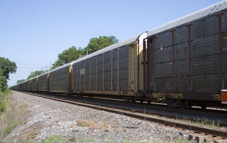 haul: View of a railroad train on a bright day.