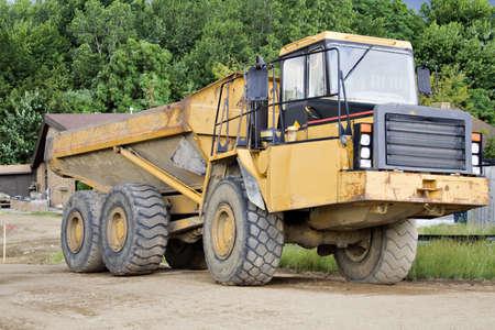 earthmover: Large dump truck - earthmover on a construction site.
