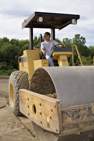Large Construction Roller - man operating Stock Photo - 440177