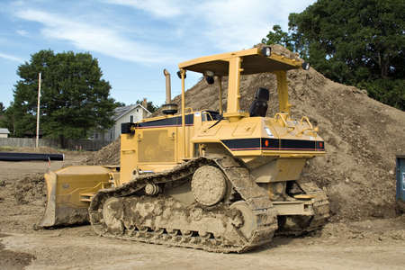 Bulldozer parked in front of a construction project. Stock Photo - 441722
