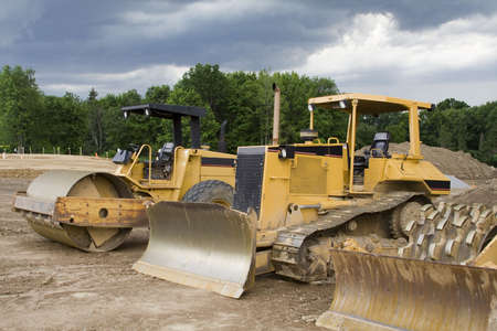 Construction Machinery - dozers, earthmovers, etc. on construction site - stormy sky Stock Photo - 444000