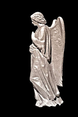 A stone statue of an angel  on black background- special effects applied.