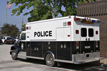 A police paddy wagon parked outside the police station. Stock Photo