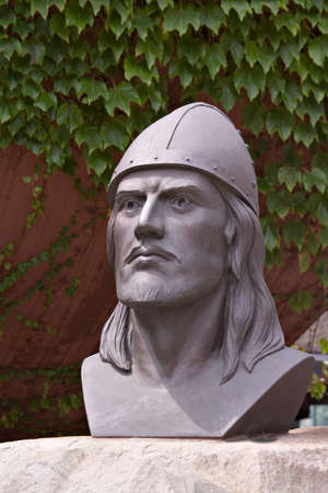 leif: Bust of Leif Ericson against a backdrop of ivy.