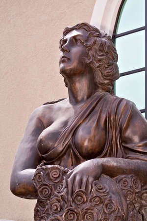 bared: Bronze statue of a woman - one bared breast. Stock Photo