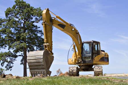 Large backhoe on construction site - Summertime