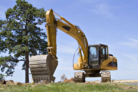 Large backhoe on construction site - Summertime Stock Photo - 495834