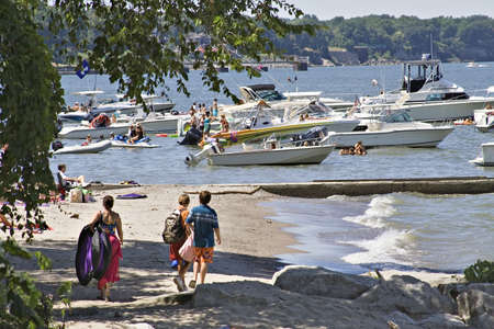 Playtime on Lake Erie - Rocky River, Cleveland, Ohio; Boaters and family fun. Stock Photo