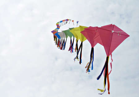 Several kites flying on a single lead - poetry in motion. Stock Photo