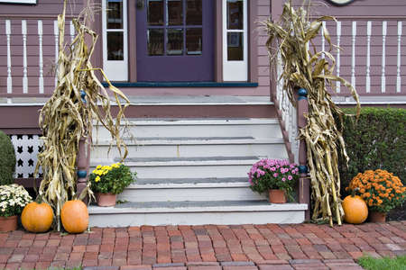 Front Porch steps decorated for the fall season.