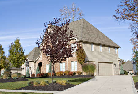 housing lot: Large house with three car attached garage. Stock Photo