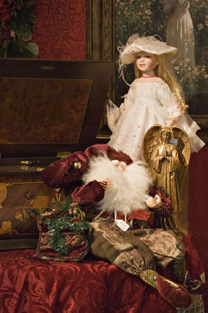A beautiful Victorian Christmas display. Porcelain doll, angel, Santa, toys, large music box. Rich fabrics in jewel and metallic colors.   Banco de Imagens