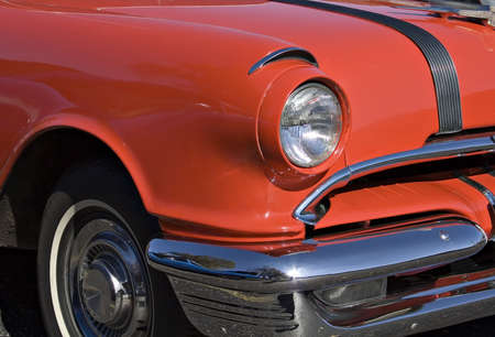 hubcaps: Old red classic American Car.