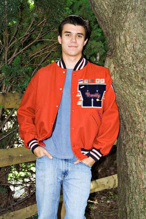 red coats: A high-school senior in his school varsity letter jacket.