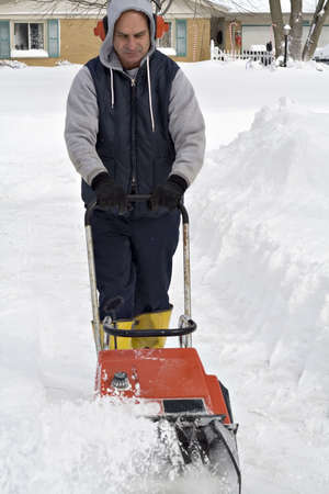 Ohio man digging out after a winter snow storm. photo