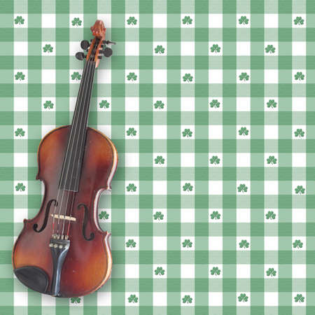 A violin (fiddle) on a shamrock gingham digital background.  All elements and brushes created by Denise Kappa Stock Photo - 780630