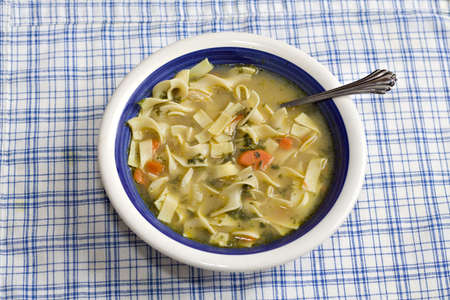 noodle soup: A bowl of homemade chicken noodle soup. Stock Photo