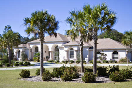 florida house: A sprawling Floirda residential home with beautiful landscaping. Stock Photo