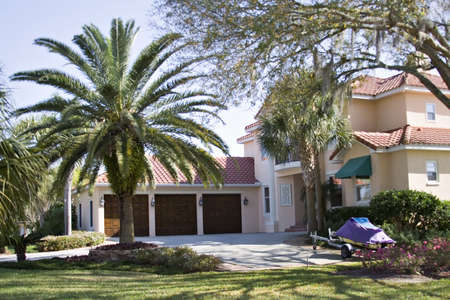 florida house: An American home in Florida - three car attached garage, clay tile roof. Stock Photo