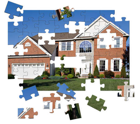 median: Concept - House Puzzle. Brick and stone colonial home in the suburbs.