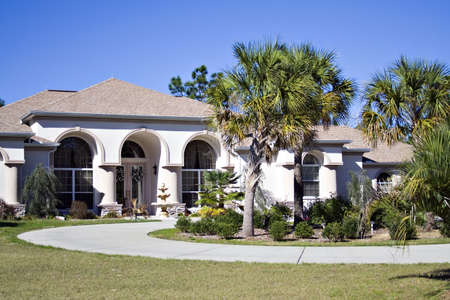 Interesting achitecture - florida home with curved driveway. Stock Photo - 844903