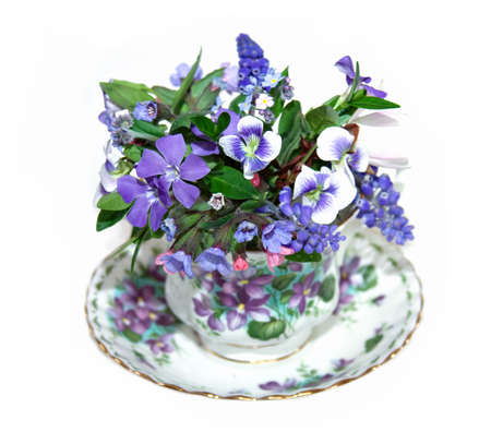 appropriate: A china cup filled with appropriate spring flowers.  Stock Photo
